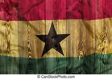 National flag of Ghana, wooden background