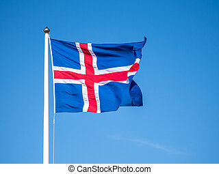 Flag of Iceland waving on the wind with blue sky background