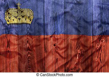 National flag of Liechtenstein, wooden background
