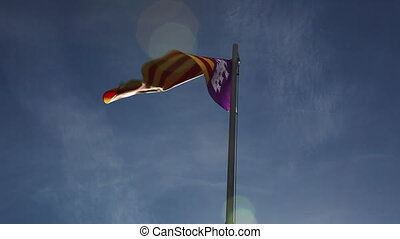 National flag of Majorca on a flagpole in front of blue sky