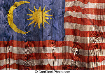National flag of Malaysia, wooden background