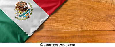 National flag of Mexico on a wooden background with copy space
