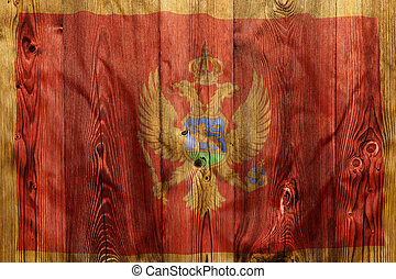 National flag of Montenegro, wooden background