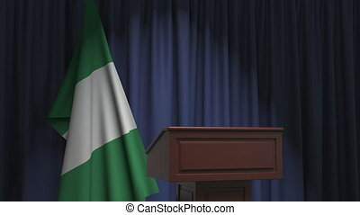 National flag of Nigeria and speaker podium tribune. Political event or statement related conceptual 3D animation