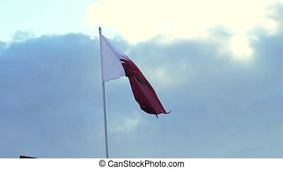 National Flag Of Qatar on sky background