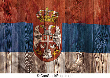 National flag of Serbia, wooden background