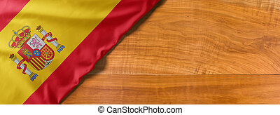 National flag of Spain on a wooden background with copy space