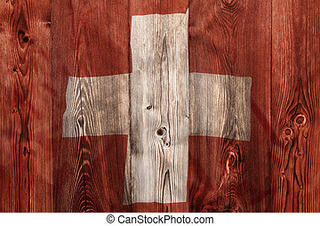 National flag of Switzerland, wooden background