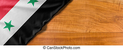 National flag of Syria on a wooden background with copy space