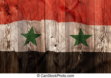 National flag of Syria, wooden background