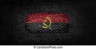 National flag of the Angola on dark fabric