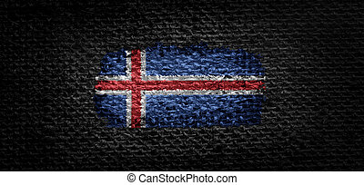 National flag of the Iceland on dark fabric