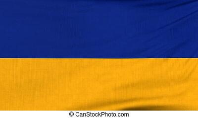 National flag of Ukraine flying on the wind