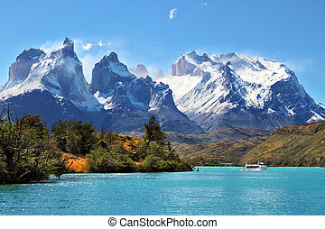 National Park Torres del Paine, Chile. Azure Lake Pehoe at the foot of the magnificent snow-covered cliffs of Los Kuernos