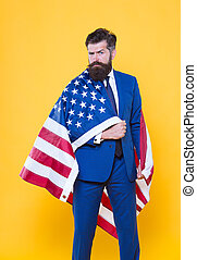 National pride. Bearded man wearing national flag of the USA on formalwear. Confident businessman celebrating national holiday on july 4th. National business manager on yellow background