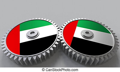 National project. Flags of the United Arab Emirates UAE on moving cogwheels. Conceptual 3D rendering