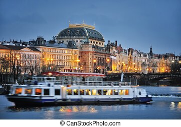 National Theater building in Prague, Czech Republic with Vitava River at sunset