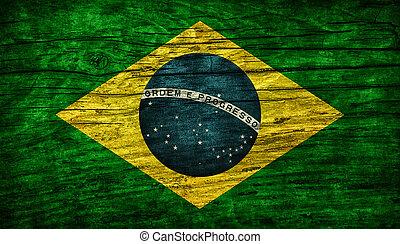 National vintage flag of Brazil on wooden surface