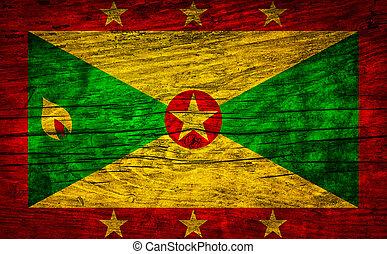 National vintage flag of Grenada on wooden surface