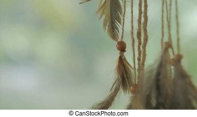 Native American dreamcatcher blowing in breeze - Closeup...