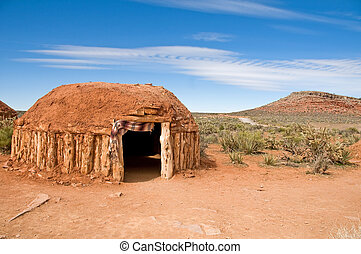 Native american dwelling - a traditional mud and wood native...