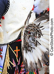 Native american indian dancer performing outdoors.