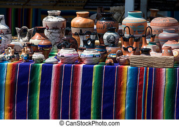 native american pottery on colorful display table