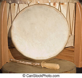 Native American Shaman Pow Wow hand drum and beater leaning against large drum