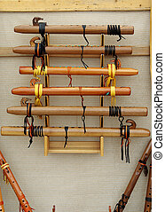 Native American wooden flutes decorated with wood carving and leather strips