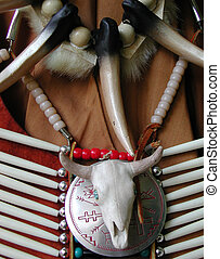 Native breastplate with claws and steer skull and beads