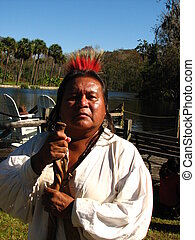 A full blood Cherokee grew up on a portion of the Cherokee reservation in an area called Snowbird.