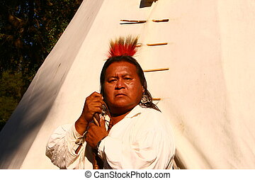 A full blood Cherokee who grew up on a portion of the Cherokee reservation in an area called Snowbird.