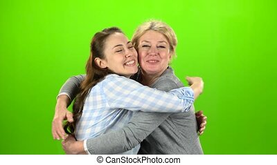 Native hugs, they are stand and talking. Green screen -...