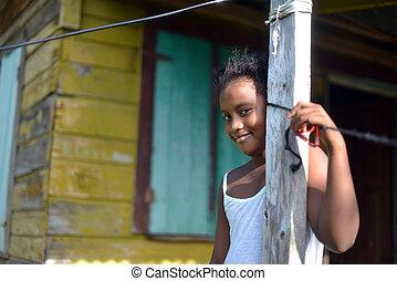 native Nicaraguan girl smiling clapboard house Big Corn...