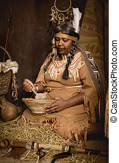 Native old squaw - Weathered mature tribal female...