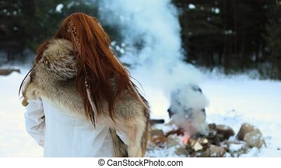 Native warrior man lights camp fire - A mystical shaman ...