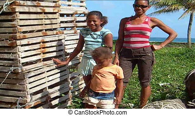 natives Nicaragua waving hello - mother and daughters waving...