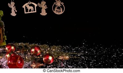 Nativity scene and Christmas collection on black background. Christmas decoration. Christmas balls.