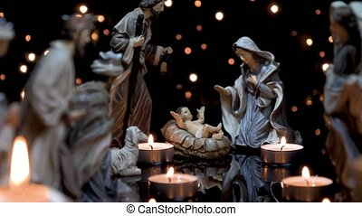 Nativity scene Christmas manger with candles lights