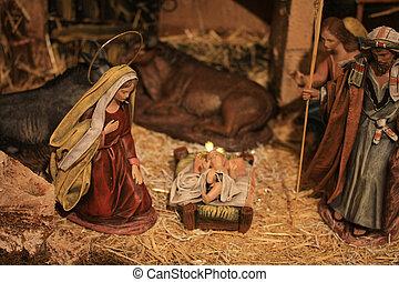 Nativity scene, virgin Mary and baby Jesus in the crib