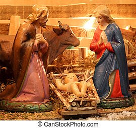 nativity scene with holy family in a manger