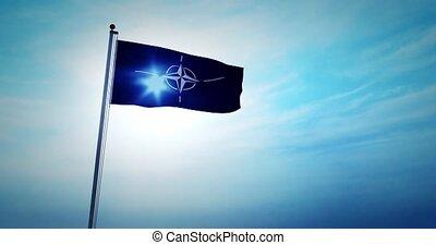 NATO flag waving depicts North Atlantic treaty organization...