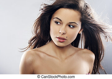 natural and beautiful girl with winblowed hair on light ...