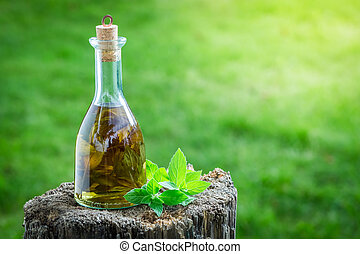 Natural and homemade liqueur with mint and alcohol
