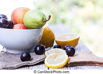 Natural background. Fruits on wooden table.