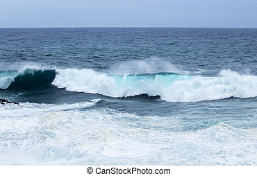 ocean waves breaking - natural background of foamy ocean...