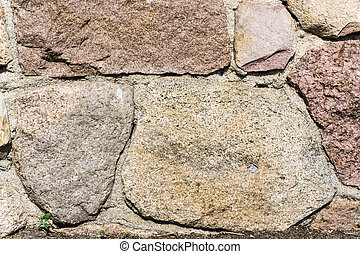 Natural background - stone wall in sunshine