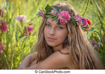 natural beauty and health, woman with flowers in hair.