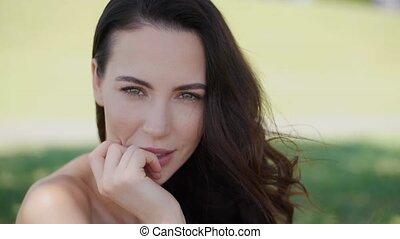 Beautiful woman, fashion model with long brown hair sitting...