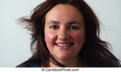 natural beauty happy woman portrait smiling with blowing...